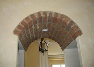 Об эффектной отделке арки декоративным камнем
